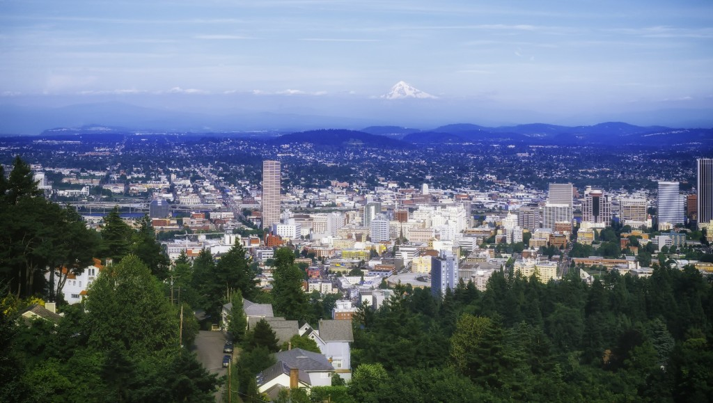 The lush greenery and Tualatin Mountains that surrounds Portland make it an attractive city to live.